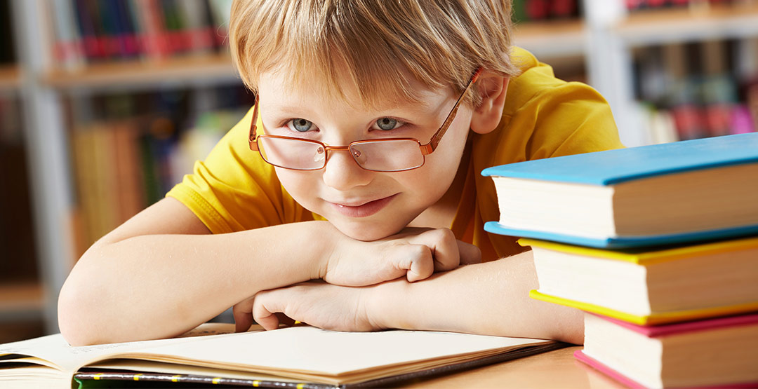 child-with-glasses-reading