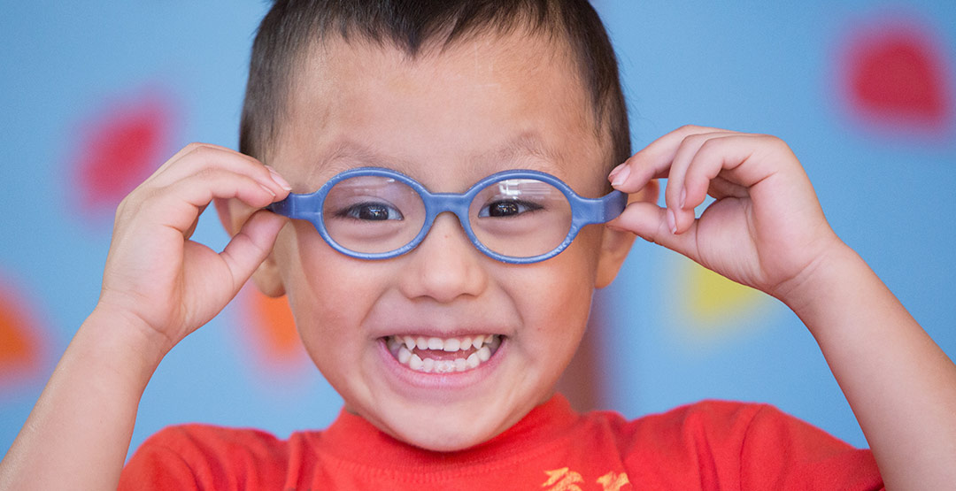 smiling-child-with-glasses